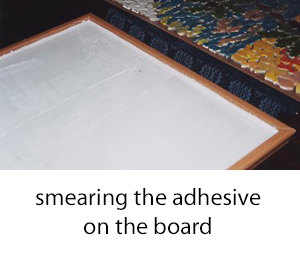 mastic applied to the board before mounting tiles